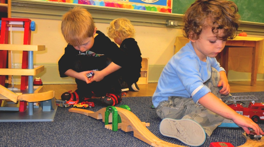 Nicholas and Emerson playing with trains